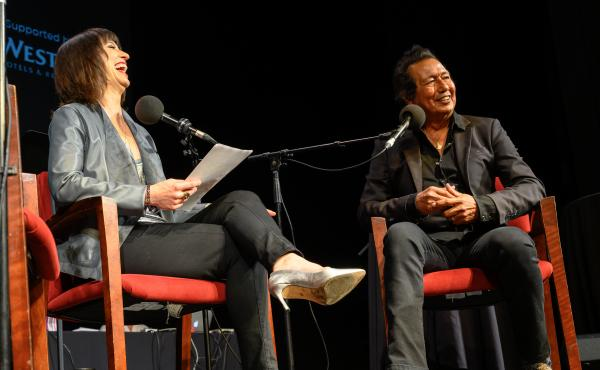 Host Ophira Eisenberg with Alejandro Escovedo on Ask Me Another at the Majestic Theatre in Dallas, Texas.