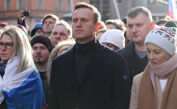 Alexei Navalny is seen during a rally in Moscow last year along with his wife, Yulia (right). She and his personal doctor were reportedly prevented from seeing him in the hospital.