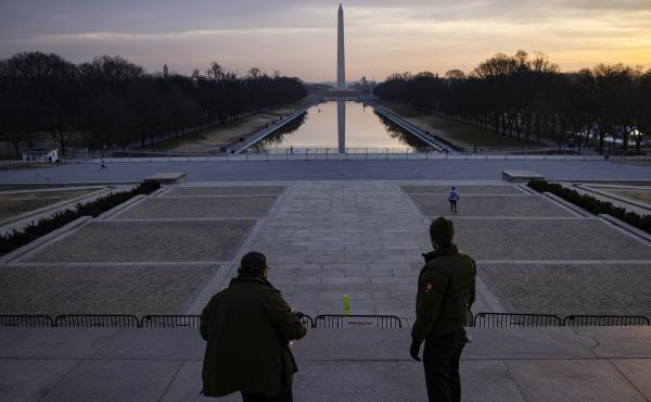 "U.S. park rangers look at the spot where the Rev. Martin Luther King Jr. gave his famous ""I Have a Dream"" speech on the steps of the Lincoln Memorial in Washington, D.C., on Friday. Security threats have prompted officials to shut down the National Mall a"