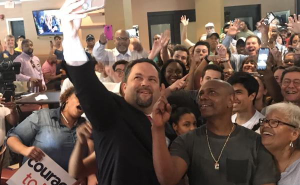 Dave Chappelle (second from right) put his celebrity to work at a campaign event for Ben Jealous (left) on Friday.
