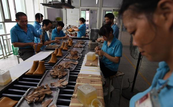 Workers assemble shoes in 2016 at a Huajian shoe factory in southern China, where about 100,000 pairs of Ivanka Trump-branded shoes have been made over the years.