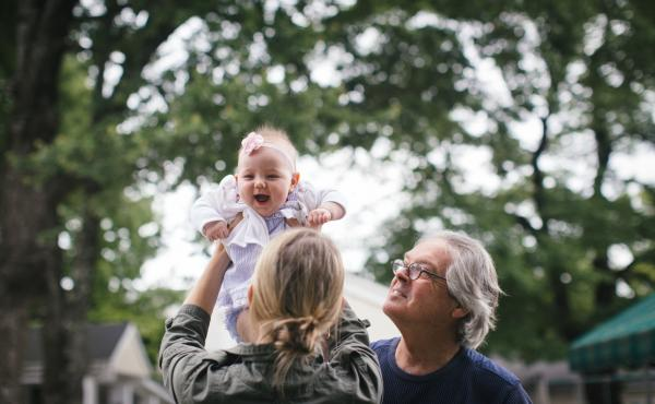 Writer Greg O'Brien and his daughter, Colleen, play with Adeline, Greg's 8-month-old granddaughter. Eight years ago, Greg was diagnosed with Alzheimer's disease.