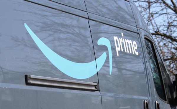 An Amazon delivery truck seen on Wednesday in Plainview, New York. The online retailer says an employee at a warehouse in New York City has tested positive for coronavirus.