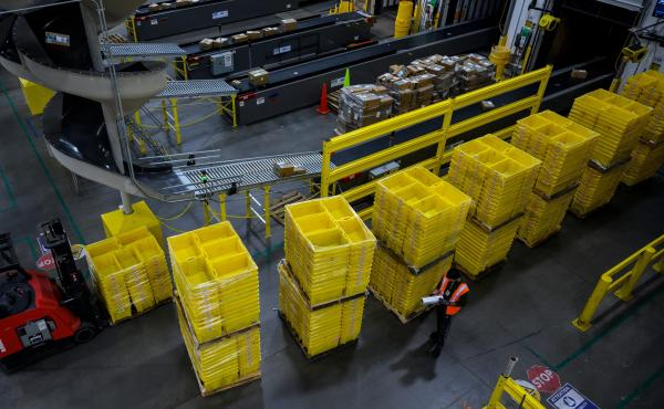 A man works at an Amazon fulfillment center in Staten Island, New York. The retail giant faces a major labor battle with a unionization vote planned at a similar warehouse in Alabama.