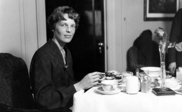 Amelia Earhart eats dinner at a Cleveland hotel. Her in-flight menu, however, was usually simple, often consisting of tomato juice and a hard-boiled egg.