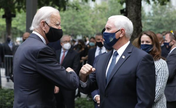 Democratic presidential candidate Joe Biden greets Vice President Pence at the 9/11 Memorial in New York to commemorate the 19th anniversary of the Sept. 11 attacks on Friday.