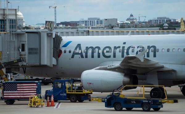An American Airlines plane is seen at a gate at Ronald Reagan Washington National Airport in Arlington, Va., on May 12, 2020.