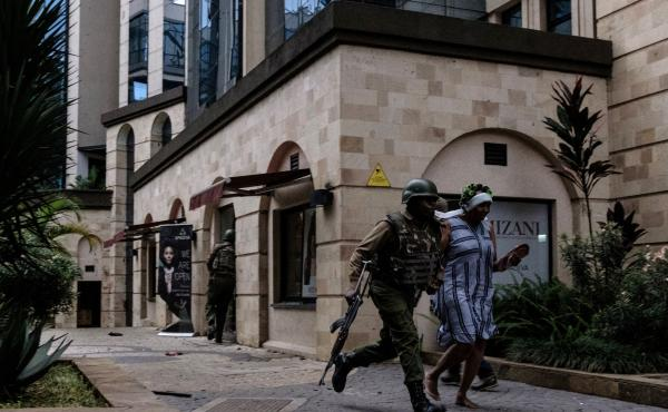 Kenyan security forces evacuate people after an explosion at DusitD2 hotel in Nairobi, Kenya, on Tuesday.