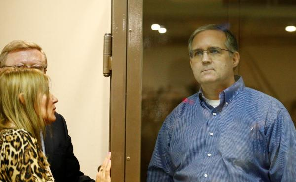 Paul Whelan, the American who has been detained by Russia on suspicion of espionage, stands in a glass cage for a hearing in Moscow on Tuesday.