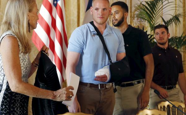 U.S. ambassador to France Jane Hartley presents U.S Airman 1st Class Spencer Stone, student Anthony Sadler and National Guardsman Alek Skarlatos at a news conference at the U.S. Embassy in Paris on Sunday.