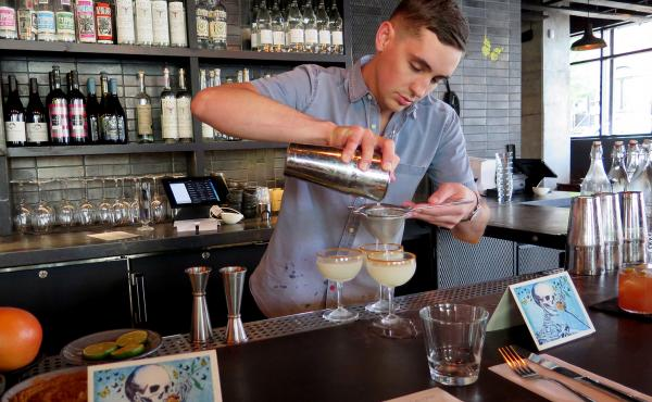 Bartender Robin Miller mixes a round of mezcal margaritas at Espita Mezcaleria in Washington, D.C. As U.S. drinkers embrace mezcal, investors are flocking south to the heart of Mexico's mezcal country, and local incomes are rising.