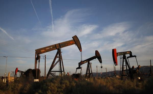 """Pump jacks and wells work in an oil field on the Monterey Shale formation in California. Economist Michael Porter says that hydraulic fracturing, or fracking, is a """"game changer"""" for the U.S. economy."""