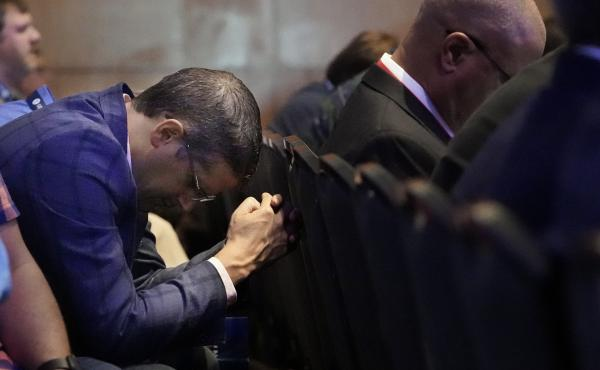 A man prays during the executive committee plenary meeting at the Southern Baptist Convention's annual gathering Monday in Nashville, Tenn.