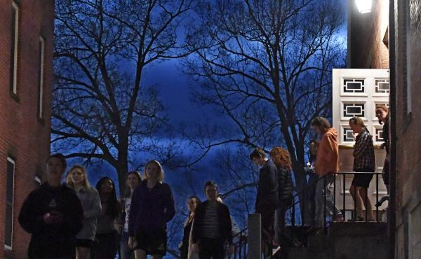 Students walk out of Johnson Chapel at Amherst College in Amherst, Mass., April 24, 2019. Amherst College will no longer give admissions preference to the children of alumni, the school announced Wednesday.