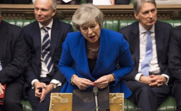 British Prime Minister Theresa May speaks Wednesday at the House of Commons in London during a debate before a no-confidence vote raised by opposition Labour Party leader Jeremy Corbyn. May withstood the challenge to her leadership.