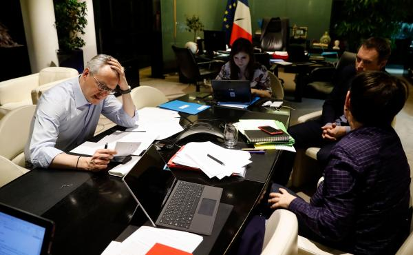 In Paris, French Economy and Finance Minister Bruno Le Maire (left) speaks on the phone with his German counterpart as his advisor Juliette Oury (center) and cabinet deputy director Thomas Revial (second right) and French Treasury director Odile Renaud-Ba