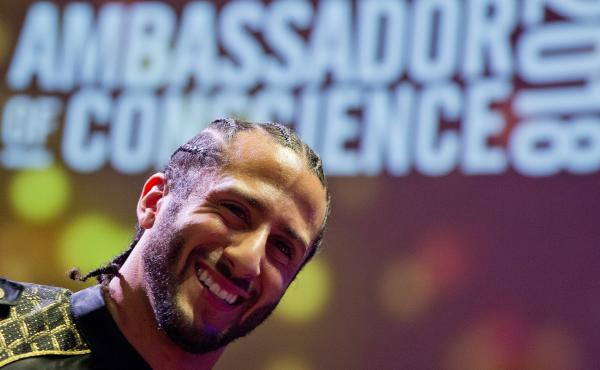 Former NFL quarterback Colin Kaepernick receives the Amnesty International Ambassador of Conscience Award for 2018 in Amsterdam Saturday. Kaepernick became a controversial figure when he refused to stand for the national anthem, and instead knelt to prote
