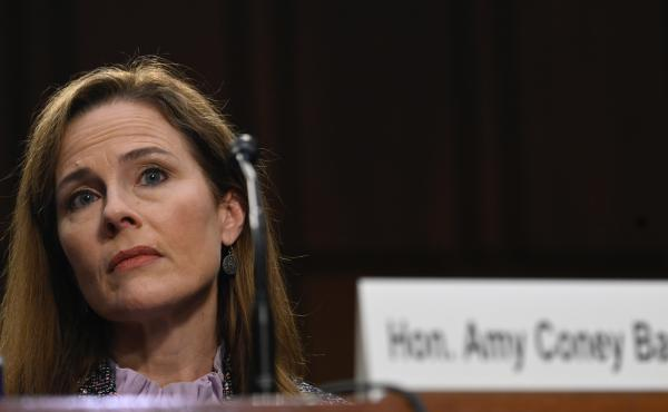 Supreme Court nominee Amy Coney Barrett testifies before the Senate Judiciary Committee on Oct. 14. On Thursday, the committee voted to advance her nomination to the full Senate for a confirmation vote.