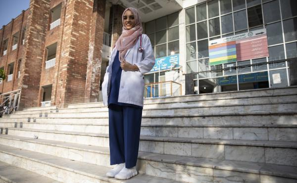 Dr. Saleema Rehman stands outside Holy Family Hospital in Rawalpindi, Pakistan. The Afghan refugee of Turkmen origin has won UNHCR's Nansen Award for her work helping refugee moms and babies in Pakistan.