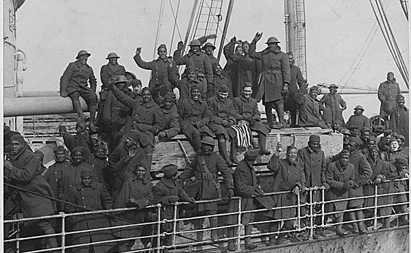 Members of New York's famous 369th Infantry Regiment wave as they come back home from France.
