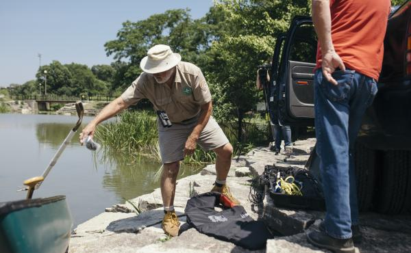 A volunteer with the Chicago Herpetological Society known as Alligator Bob sets out in his canoe to find an alligator on the loose in a Chicago lagoon this week.