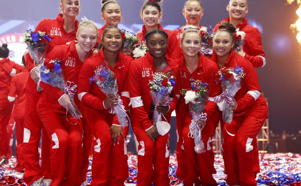 The women representing Team USA, including six team members and four alternates, pose last month after the U.S. Gymnastics Olympic trials in St. Louis. Kara Eaker, an alternate, has tested positive for the coronavirus, her gym says.
