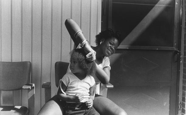 Combing Hair, Syracuse, N.Y., 1986, High Museum of Art, gift of Eric Ceputis and David W. Williams, 2017