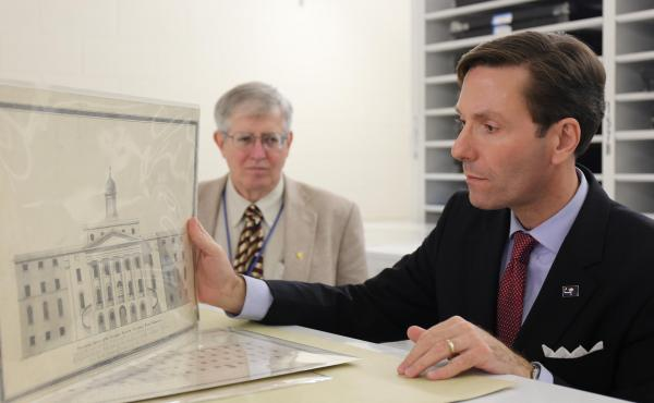Pat McCawley (left) and Eric Emerson look at a drawing of an asylum built in Columbia, S.C., in the 1820s.