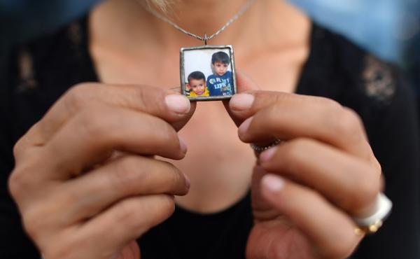 Tima Kurdi holds her necklace bearing a photograph of her nephews, Alan (left) and Ghalib Kurdi. She is the author of The Boy on the Beach: My Family's Escape from Syria and Our Hope for a New Home.
