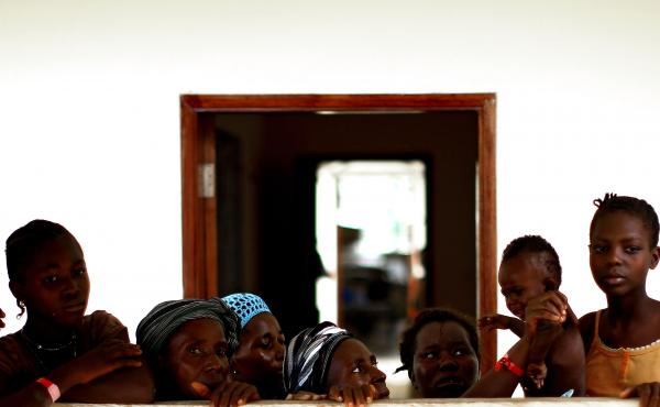 Women and children wait in the recovery area at the Hastings Ebola Treatment Center in Freetown, Sierra Leone. About 60 patients at the facility were almost ready to go home after recovering from Ebola.
