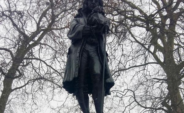 "A statue of Edward Colston towers over a square off Colston Avenue in Bristol, England. A small plaque calls Colston ""one of the most virtuous and wise sons"" of the city. Officials plan to install another plaque explaining his links to the Atlantic slave"