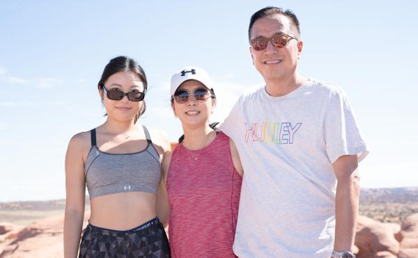 Lindsey Cho (left) with her mother, Judy Lee, and her father, Wesley Cho, after taking their turn at Delicate Arch.