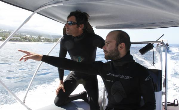 Surfer Alexis Gazzo (left) is helping train specialized lifeguards who will survey the waters around popular beaches in Reunion for sharks. Shark attacks have gone up sharply along the coast of the Indian Ocean island, with seven people killed in recent y