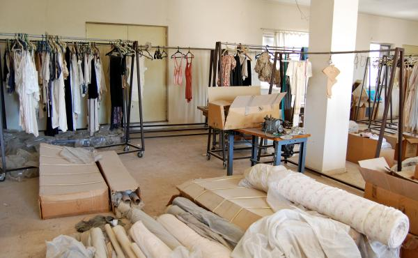 The lingerie factory was opened in the West Bank in the 1980s in an attempt to develop the Palestinian economy. The factory was shut in 1990 amid bouts of West Bank violence and troubles with Israeli military regulations. Racks of robes and camisoles stil