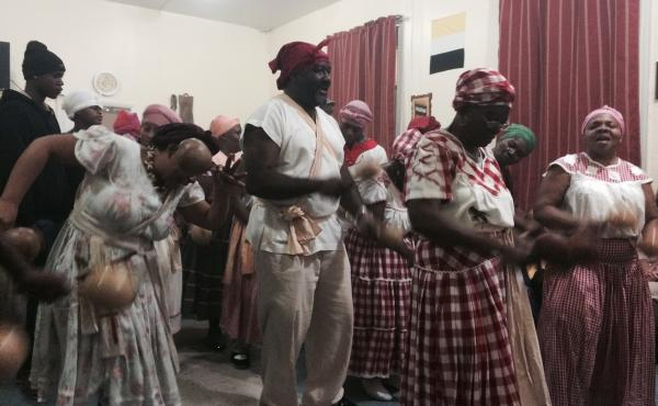 A December celebration launching a partnership between members of the Garifuna community and a doctor in New York. The collaboration is aimed at reducing the HIV infection rate among the Garifuna.
