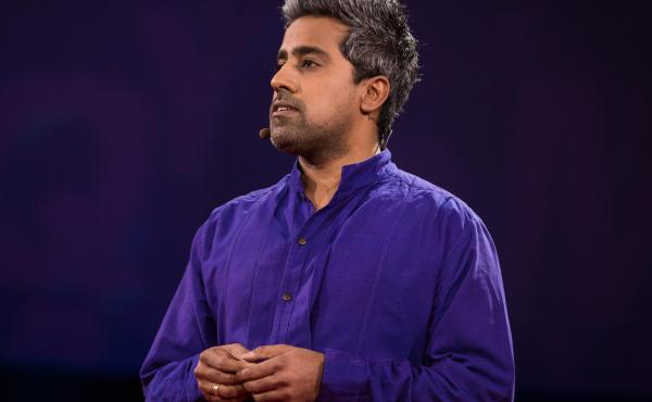 Anand Giridharadas on the TED stage.