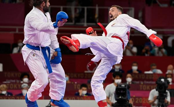 Azerbaijan's Rafael Aghayev (L) competes against Hungary's Karoly Gabor Harspataki in the men's kumite -75kg semi-final of the karate competition during the Tokyo 2020 Olympic Games on Friday.