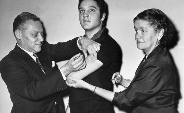 Elvis Presley receives a polio vaccine in New York City in 1956 in an effort to inspire public confidence in the vaccine. The Ad Council says it will be recruiting trusted influencers for its campaign around the coronavirus vaccine.