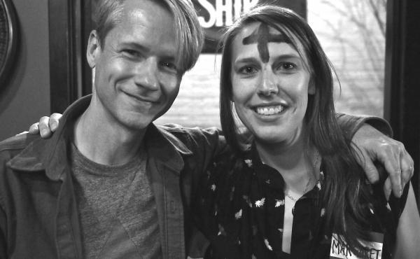 John Cameron Mitchell (left) with grand winner Margaret Bortner, post face-painting.