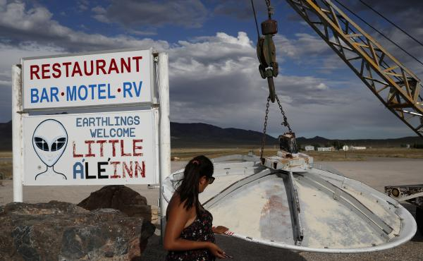 Grace Capati looks at a UFO display outside of the Little A'Le'Inn, in Rachel, Nev., the closest town to Area 51, the top-secret Cold War test site in the Nevada desert.