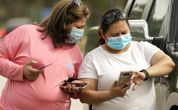 Women wear masks in Houston Wednesday. Harris County requires any business providing goods or services to require all employees and visitors to wear face coverings in areas of close proximity to co-workers or the public, at least through Aug. 26.