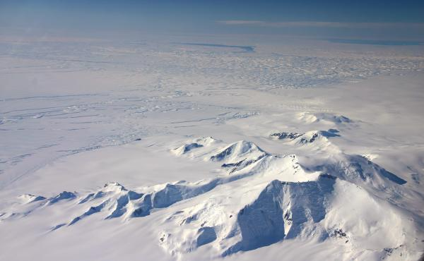 This image taken in 2012 shows part of the Crosson Ice Shelf (center left) and Mount Murphy (foreground) on the western edge of Antarctica. Thwaites Ice Shelf lies beyond the highly fractured expanse of ice (center).