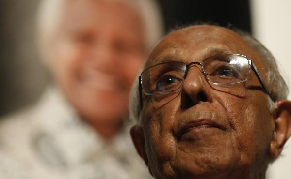 "Anti-apartheid activist Ahmed ""Kathy"" Kathrada talks during a tribute to his close friend and former South African President Nelson Mandela at Gandhi Hall on Dec. 8, 2013, in Johannesburg. Kathrada died on Tuesday at 87."