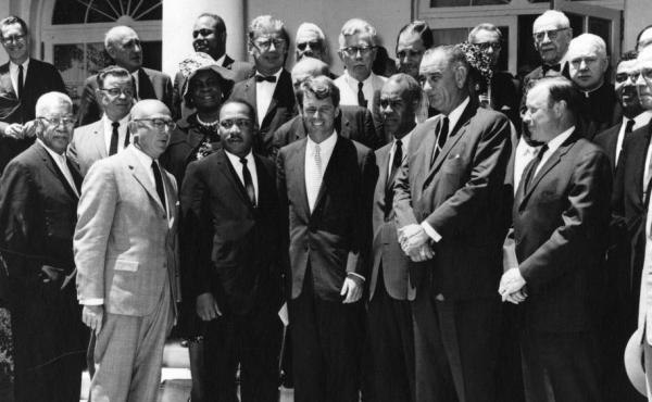 Benjamin Epstein, director of the Anti-Defamation League, stands to the right of Martin Luther King Jr. in this photo with Attorney General Robert F. Kennedy and Vice President Lyndon B. Johnson taken on June 22, 1963.
