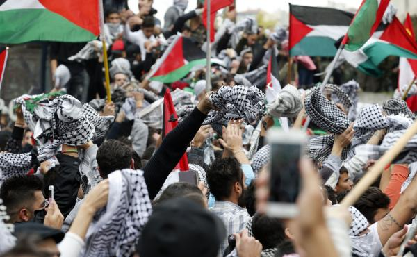 Protesters in Beirut waved the Palestinian flag Sunday in response to President Trump's decision to recognize Jerusalem as Israel's capital. The move marked a dramatic shift from decades of American foreign policy.