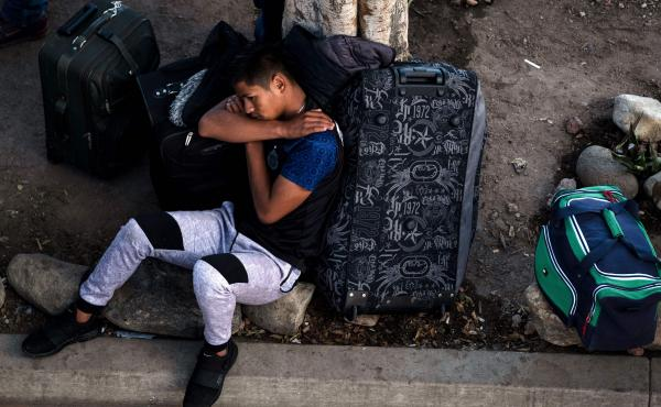 An asylum-seeker rests outside El Chaparral port of entry while he waits for his turn to present himself to U.S. border authorities to request asylum, in Tijuana, Mexico, last month. A federal appeals court has granted the Trump administration's request t