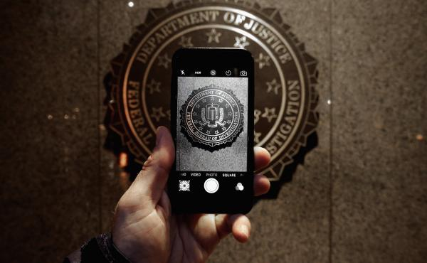 The official seal of the Federal Bureau of Investigation is seen on an iPhone's camera screen outside the J. Edgar Hoover headquarters in Washington, D.C. Apple is facing off with the FBI in court over investigators' request that the tech giant help them