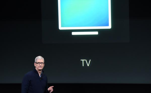 Apple CEO Tim Cook introduces the new Apple TV app during a product launch event in Cupertino, Calif., in October. The company now plans to make original movies and TV programming, according to sources.