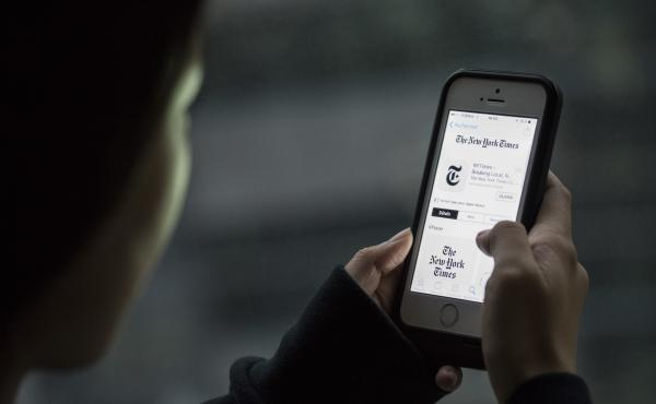 A user in Beijing looks at The New York Times app on an iPhone.