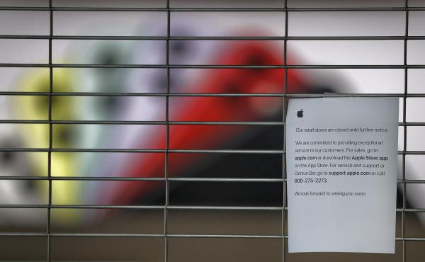 A sign on a shuttered Apple Store at the International Plaza shopping center in Tampa, Fla. The location has been closed because of the coronavirus pandemic and is scheduled to reopen Thursday.